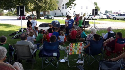 Children's time during outdoor worship service at Camp East Union Aug 28