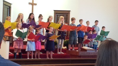 Children singing during recent worship sevice